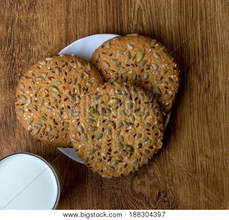 The Composition Of Biscuits And A Glass Jar With Milk.
