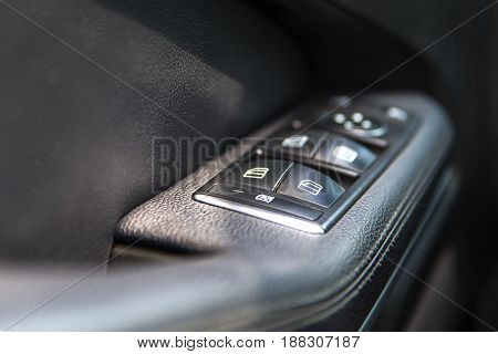 Car window control panel. Car interior detail.