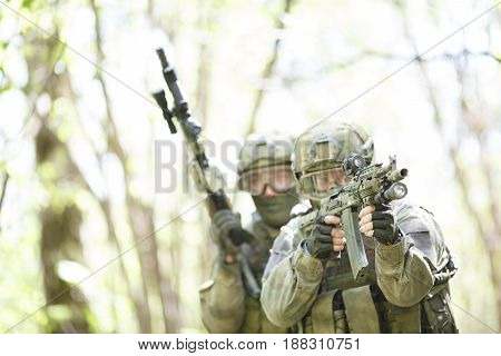 Portrait of soldiers with gun in woods afternoon