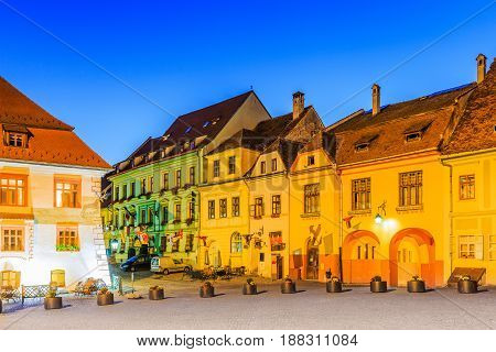 Sighisoara Romania. Old town square at twilight.