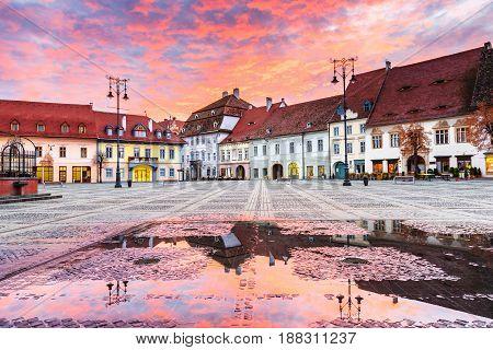 Sibiu Romania. Large Square (Piata Mare) at sunrise. Transylvanian medieval city.