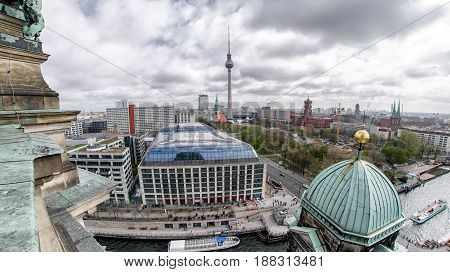 BERLIN GERMANY - APRIL 8: The Fernsehturm - television tower in Berlin. View from a top of Berlin cathedral on April 8 2017 in Berlin