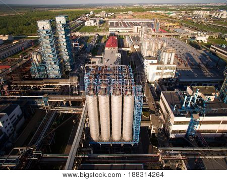 On a big site plant located distillation systems, oil reservoirs, coolers etc