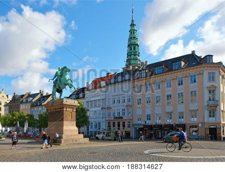 COPENHAGEN DENMARK - AUGUST 22 2014: Hojbro Plads is the square in the historical center of Copenhagen. The main feature of this square is equestrian statue of Bishop Absalon founder of Copenhagen.