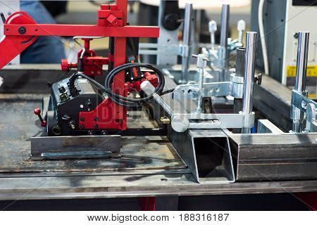 Operator machining automotive part by turning machine, Industry machine background