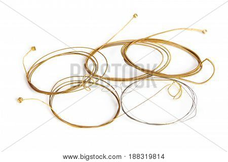 Twisted copper guitar strings on a white background