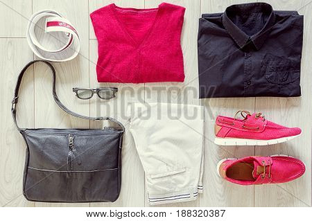Set of men's clothes consist of trousers, sneakers, sweater, T-shirt, bag, belt and glasses