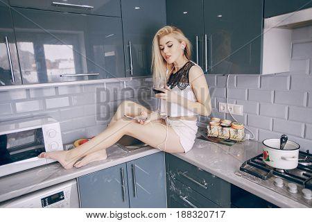 beautiful seductive girl in the kitchen HD