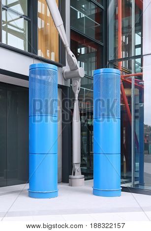 Large ventilation system air pipes outside modern building