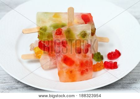Homemade ice lolly from Jelly candies and funny popsicle for children