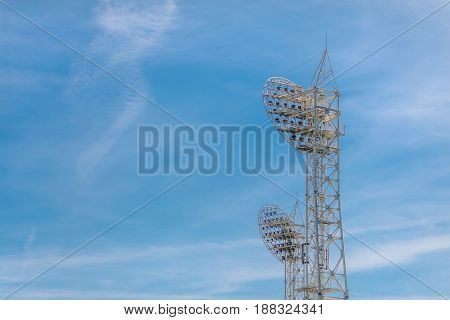 Stadium light against blue sky. Sports architecture and equipment