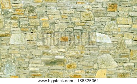 A pattern of flat stones. Surface stone wall background. Grey stone wall background.
