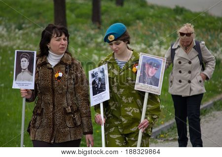 Donetsk Ukraine - May 09 2017: Women participating in procession immortal regiment with portraits of relatives of those killed in the Second World War and in the conflict in Donbass