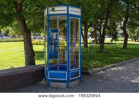 Donetsk Ukraine - May 17 2017: Abandoned telephone booth with the Ukrtelecom brand in the center of the city