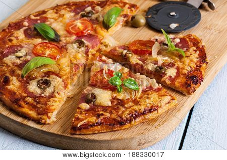 Slices Of Pizza With Bacon, Olives And Tomatoes