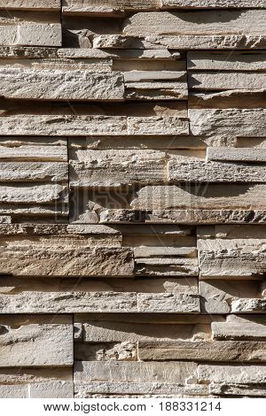 Wall made of the narrow bands of stoneel