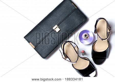 Clutch and sandals heel on white background isolation