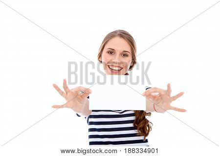 Student girl showing  white blank sheet - copy space, isolated over background