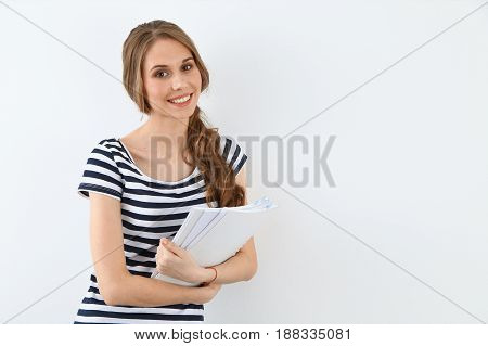 Student Girl standing near ther wall. Education concept