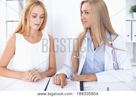Doctor with patient in hospital. Medicine and health care concept