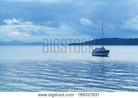 A boat on Lake Taupo at dusk North Island of New Zealand
