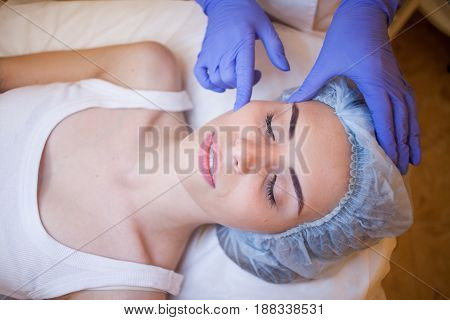 doctor cosmetologist doing facial massage girl spa 1