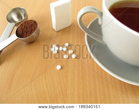Cup of black coffee with sweetener tablets