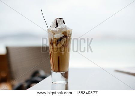 coffee with ice cream on beach. Frappe