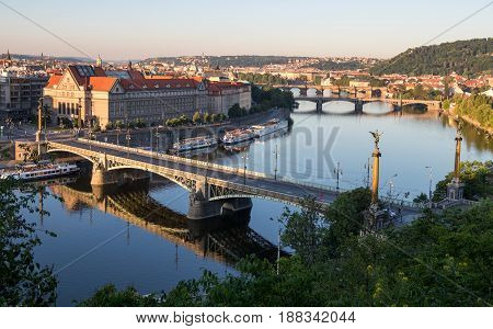 PRAGUE CZECH REPUBLIC - MAY 28 2017: Prague panorama in the morning - the Vltava river bridges and the Faculty of Law of the Charles University