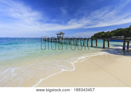 Wood Bridge Pier On Summer Tropical Sea In Blue Sky.