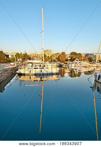 boats reflected on sea at Marina Alimos Attica Greece