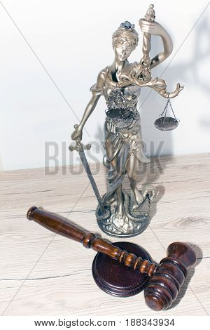 Law and Justice concept. Mallet of the judge scales of justice. Courtroom theme.