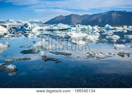 Beautiful view of icebergs in Jokulsarlon glacier lagoon Iceland global warming concept selective focus