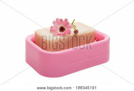 Soap dish with soap on white background