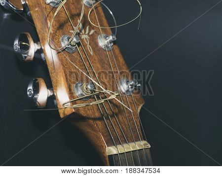 Close up of old wooden acoustic guitar. Selective focus. Acoustic guitar details.