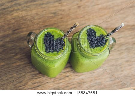 Fresh Green Smoothie With Banana And Spinach With Heart Of Sesame Seeds. Love For A Healthy Raw Food