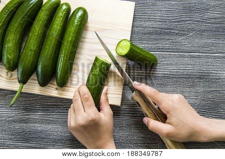 Cucumber pictures cut on the cutting board, cutting the cucumber with the knife,