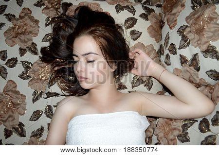 photography with scene beautiful young sleeping girl in bath towel on beautiful bed