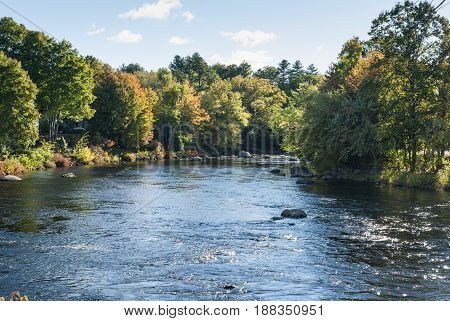 Contoocook River curving through Henniker New Hampshire in early autumn