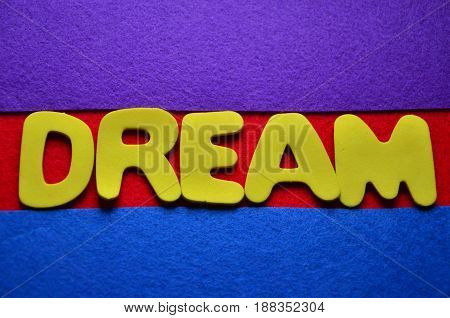 word dream on a  abstract colorful background