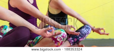Panoramic image - Group of middle aged caucasian women practicing yoga in class. Three female adults working out, sitting in meditation pose. Fitness and healthy lifestyle. Body balance training.