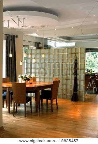 dining room with glass wall