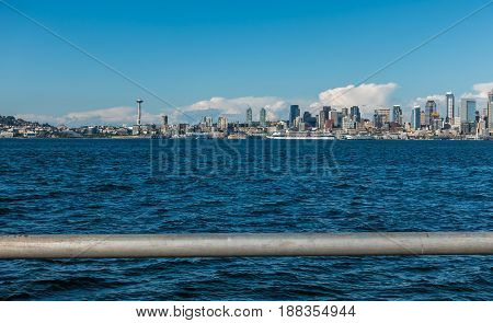 A view of the Seattle skyline with a railing in the forefround.