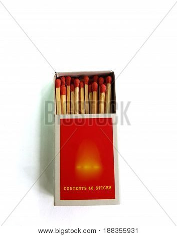Matches in a matchbox on white background,Open matchbox,Top close-up view on highlighted wooden table.