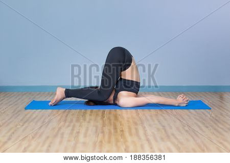 Asian young woman practicing yoga in the room and sport yogayoga in the roomsport yogayoga practiceyoga relax
