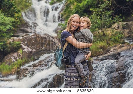 Mother And Son In The Background Of Beautiful Cascading Datanla Waterfall In The Mountain Town Dalat