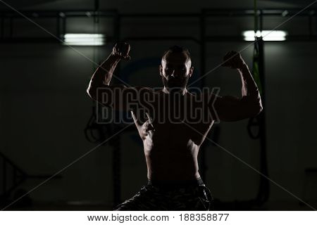 Silhouette Bodybuilder Flexing Muscles