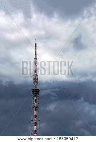 TV and radio tower metal on the background of sky with clouds