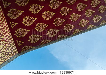 Thai style art on the roof in temple Thailand