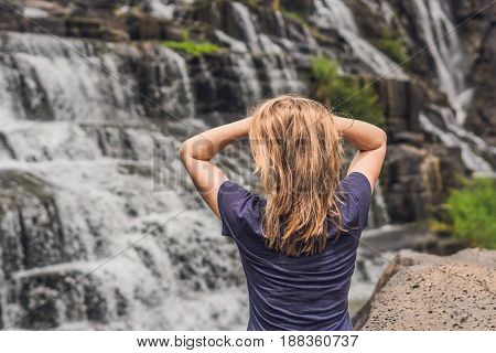 Young Woman Hiker, Tourist On The Background Of Amazing Pongour Waterfall Is Famous And Most Beautif